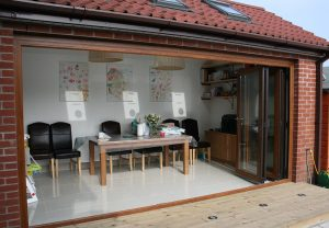 Bifold doors with timber effect uPVC