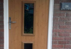 Brown composite entrance door