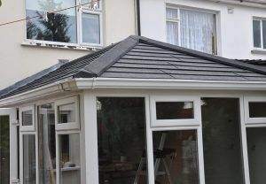 Warm conservatory roof with solid tiles