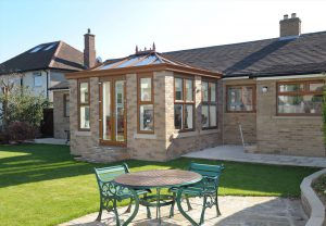 Brown orangery glazed extension