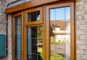 Oak Effect bay window with leaded bars